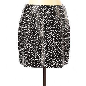 Fake leather star mini skirt